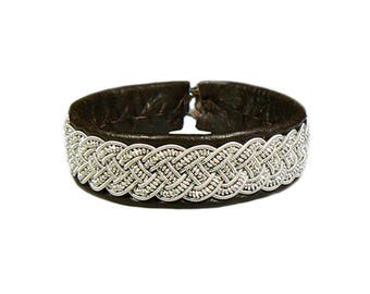 No. 1129: Sami Bracelet of pewter thread and reindeer leather.