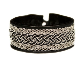 No. 1082: Sami Bracelet of pewter thread, colored copper thread and reindeer leather.