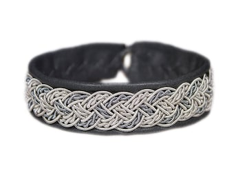 No. 1028: Sami Bracelet of pewter thread, colored copper thread and reindeer leather.