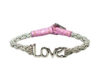No. 1112 Love:  Sami Bracelet of pewter thread, metal badge, and reindeer leather.
