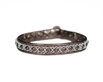 No. 1035: Sami Bracelet of pewter thread and reindeer leather.