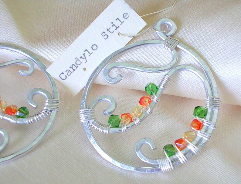 Hoop earrings handmade with hammered aluminum and faceted beads