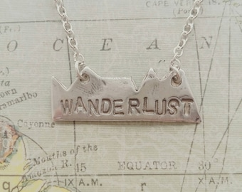 Silver handmade 'wanderlust'  necklace for travel lovers and travellers and wanderers