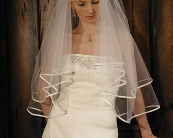 wedding veil 2layer 30/34 length with folded satin ribbon edging.