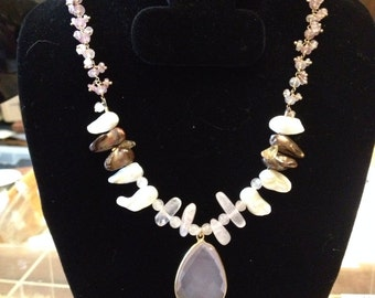 Pearl gemstone necklace with large pendant