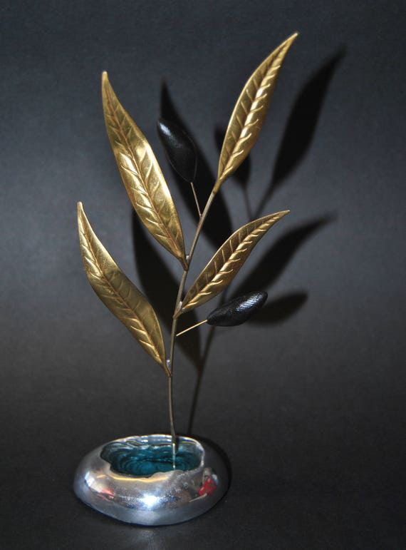 Decoration item, handmade. Aluminum base and brass olive branch. The color inside the stone is made of glass.