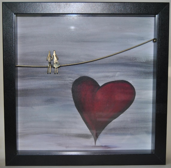 Decoration item, handmade. The figure is made of brass. The frame is wooden and the picture is a copy of a handmade painting.
