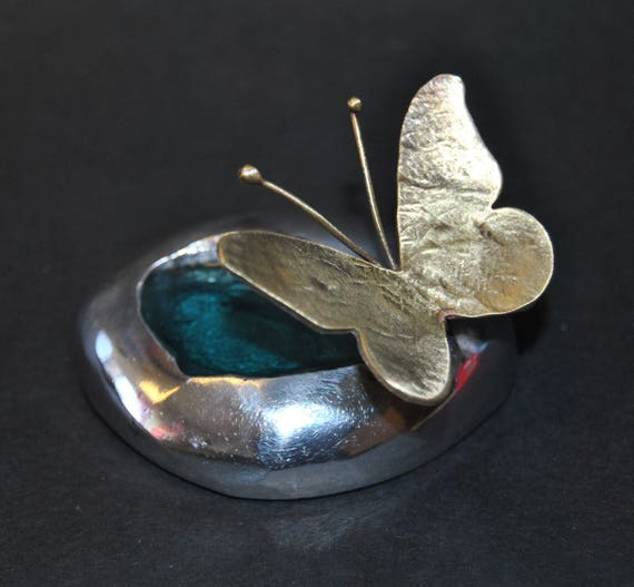 Decoration item, handmade. Aluminum sea stone and brass butterfly. The color inside the stone is made of glass.