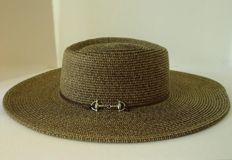 edc2832480cb0 Snaffle Bit Silver Buckle Southwestern-style wide brim straw sun hat with  chin strap.