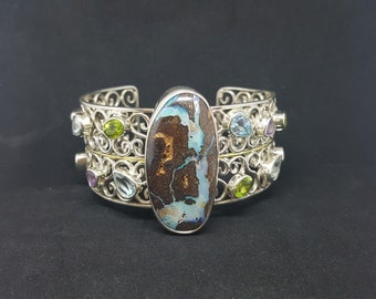 Boulder Opal with Natural Blue Topaz, Amethyst, Peridot stones Sterling silver Cuff Bracelet