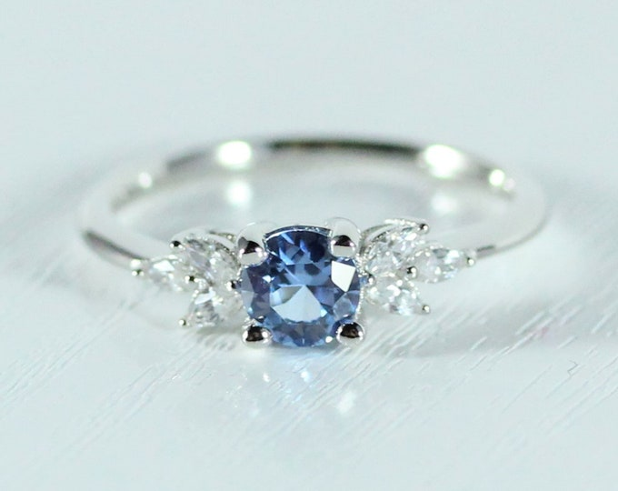 Aquamarine and diamond round & marquise solitaire engagement ring available solid gold and platinum