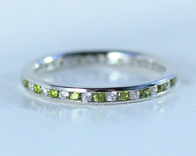 Moissanite and peridot 2.5mm wide full eternity ring avalable in 10k, 14k, 18k yellow, rose or white gold