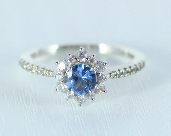 Aquamarine halo solitaire engagement ring available in 10k, 14k, 18k Rose, yellow or white gold and platinum