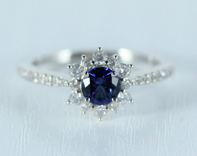 Blue Sapphire halo solitaire engagement ring available in 10k, 14k, 18k Rose, yellow or white gold and platinum