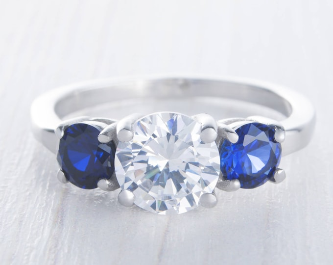 Natural Blue Sapphire and Man Made Diamond Simulant Trilogy ring available in white gold or Titanium - engagement ring - wedding ring