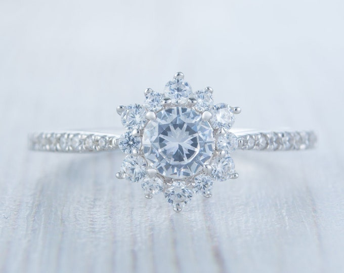 Platinum man made diamond halo solitaire engagement ring
