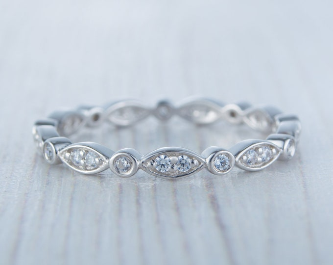 Genuine moissanite eternity / wedding ring available in Solid gold and platinum
