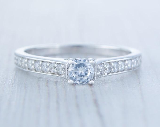 Platinum man made diamond solitaire engagement ring