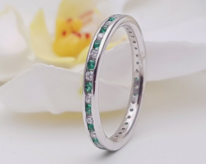 Moissanite and emerald 2.5mm wide full eternity ring avalable in 10k, 14k, 18k yellow, rose or white gold
