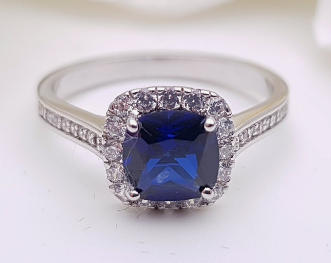 Natural Sapphire cushion cut solitaire engagement ring available in 10k, 14k, 18k Rose, yellow or white gold and platinum