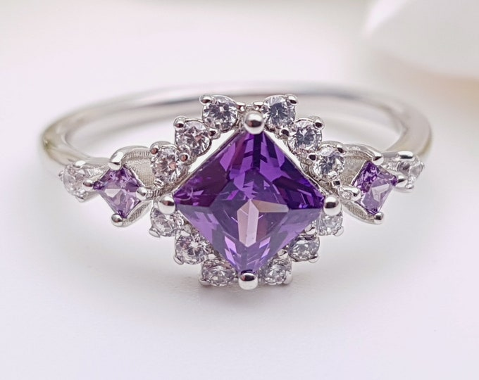 Amethyst Princess cut man made diamond halo solitaire engagement ring available in Rose, yellow or white gold and platinum