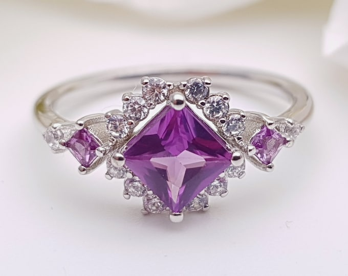 Alexandrite Princess cut man made diamond halo solitaire engagement ring available in Rose, yellow or white gold and platinum
