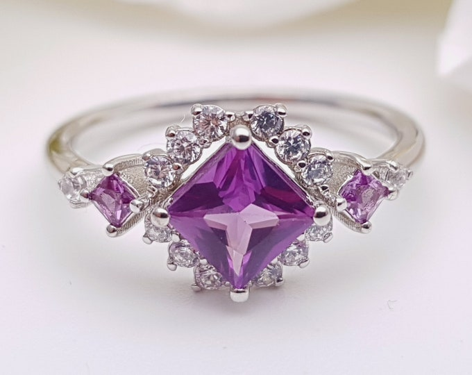 Alexandrite Princess cut man made diamond halo solitaire engagement ring available in Rose, yellow or white gold