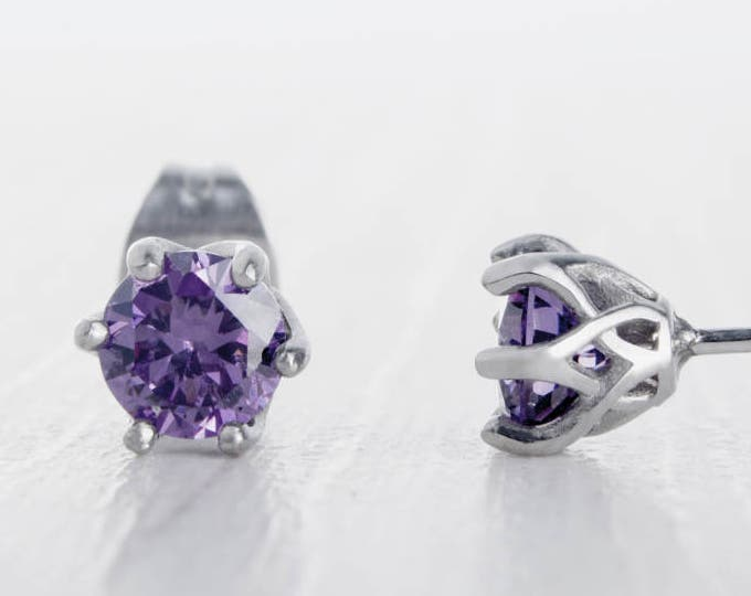 Natural Amethyst stud earrings, available in titanium, white gold and surgical steel 4mm amd 5mm sizes