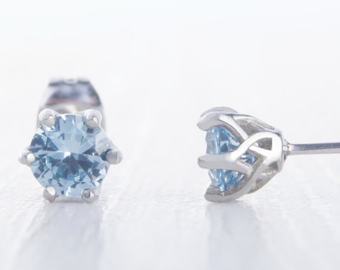 Natural Aquamarine stud earrings, available in titanium, white gold and surgical steel 4mm or 5mm sizes
