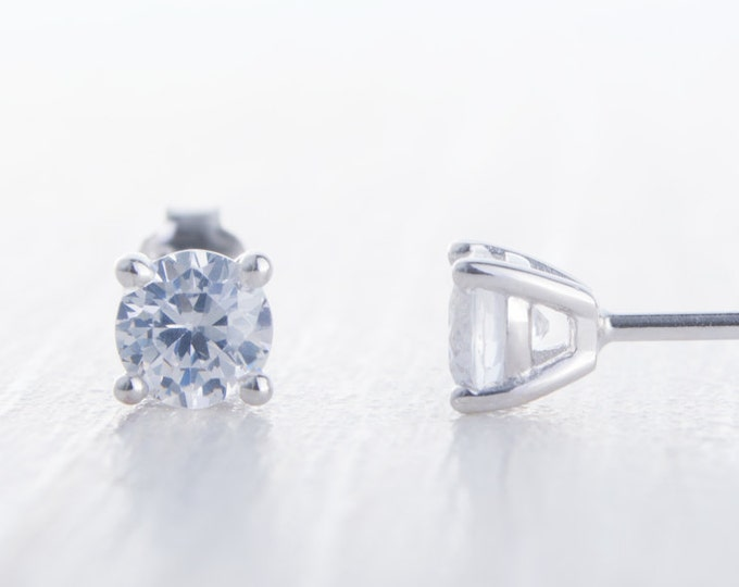 Genuine white moissanite stud earrings, available in white gold and sterling silver 3mm, 4mm, 5mm or 6mm sizes