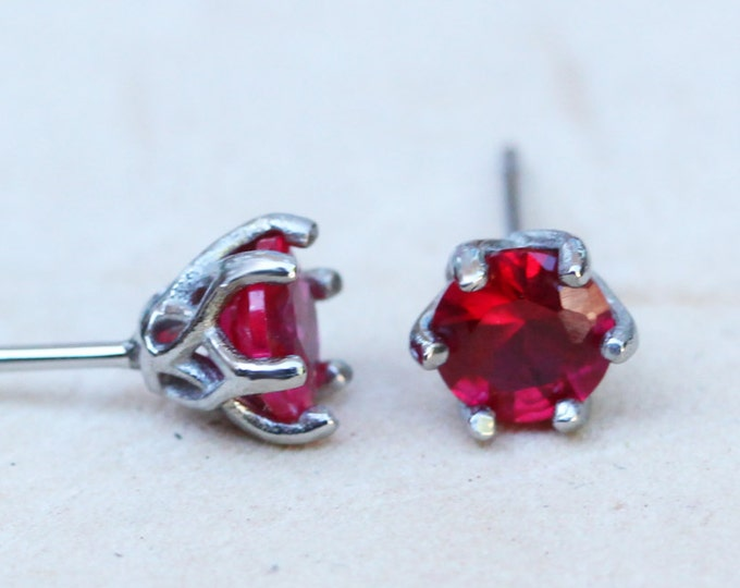 Natural Ruby stud earrings, available in titanium, white gold and surgical steel 4mm or 5mm sizes