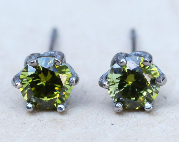 Natural Peridot stud earrings, available in titanium, white gold and surgical steel 4mm, 5mm, or 6mm sizes