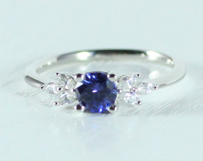 Blue Sapphire and diamond round & marquise solitaire engagement ring available solid gold and platinum