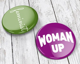 "Feminist Pins (set of 2, 1.5 in tall) | Feminist pin back buttons, feminist badge | green ""feminist,"" purple woman up 