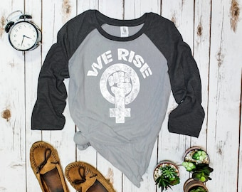 We Rise Feminist Shirt, Unisex half-sleeve t-shirt, baseball tee | Empowered women empower women | Michelle Obama | women's rights tshirt