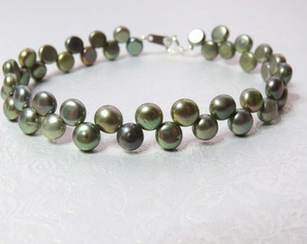 Dancing Pearls. Green Freshwater Pearl and Sterling Silver Bracelet.