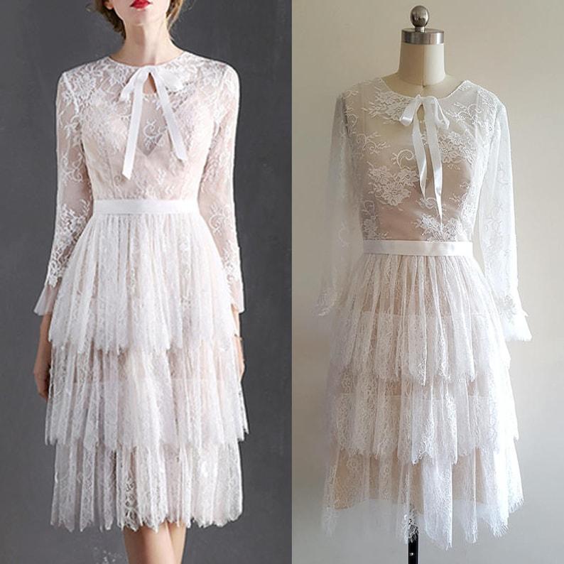 White Flapper Dresses, White 1920s Dresses     Read the full title    1920s Wedding Dress/ Boho Wedding Dress/ Flapper/ Lace Dress/ 20s/ Lace wedding dress/ long sleeve wedding dress / Bohemian wedding $514.51 AT vintagedancer.com