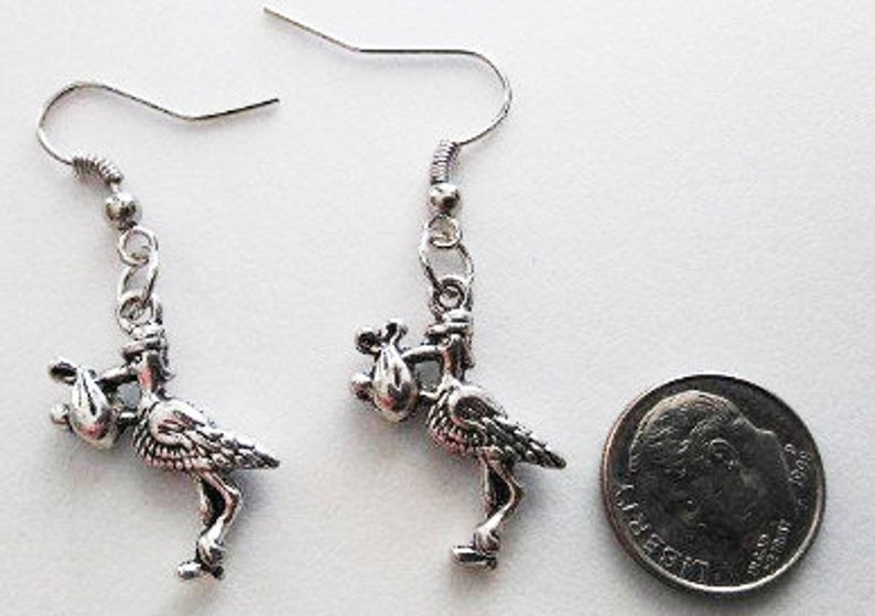 Stork with Bundle of Joy Tibetan Silver Earrings or Corded image 0