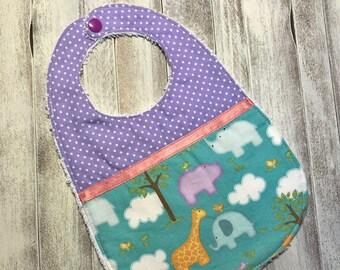 Baby bib 3-12 months purple with savannah animals.