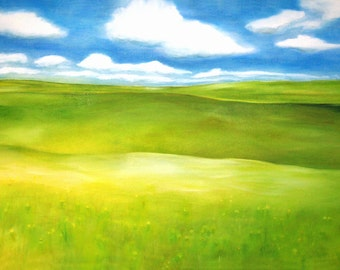 green grass and billowing blue sky