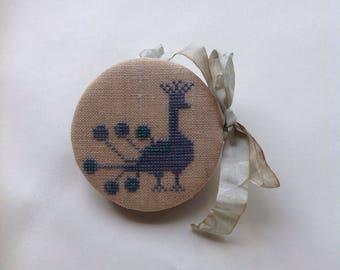 Primitive cross stitched needle case needle book with peacock.