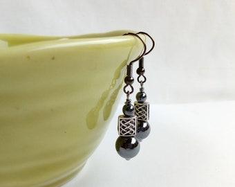 Hematite earrings with little celtic knotwork beads. Gunmetal grey findings
