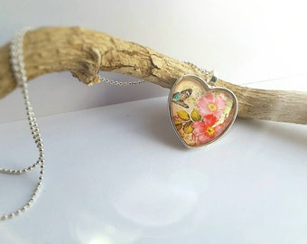 Half original price!  Wild roses heart shaped glass pendant on 24in ball chain