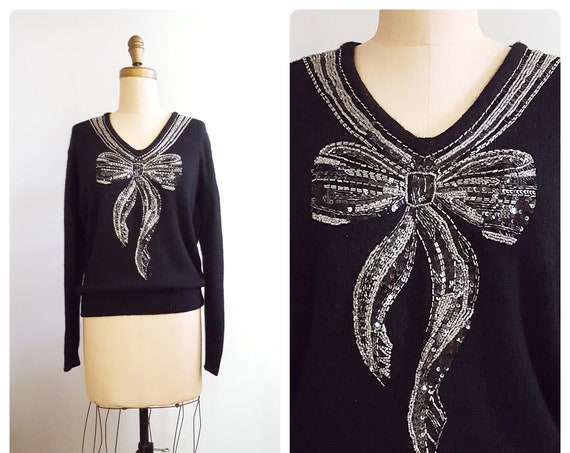 Shimmering Ribbon | 1990s black angora sweater with sequin and silver beading bow motif | 90s sequin and beaded sweater