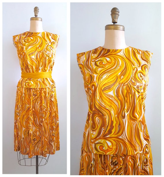 Caramel pinwheel | 1960s gold and orange nylon blouse and skirt | 60s back button top and accordian pleated skirt set
