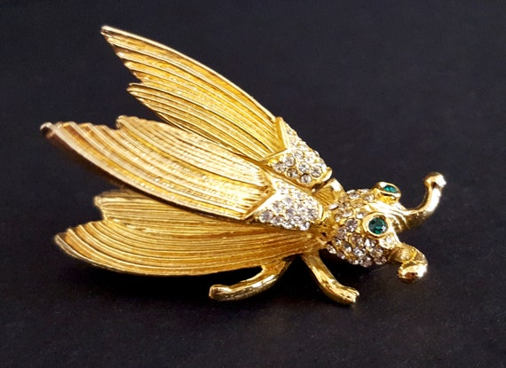 Vintage gold tone fly brooch w rhinestones and trembler wings