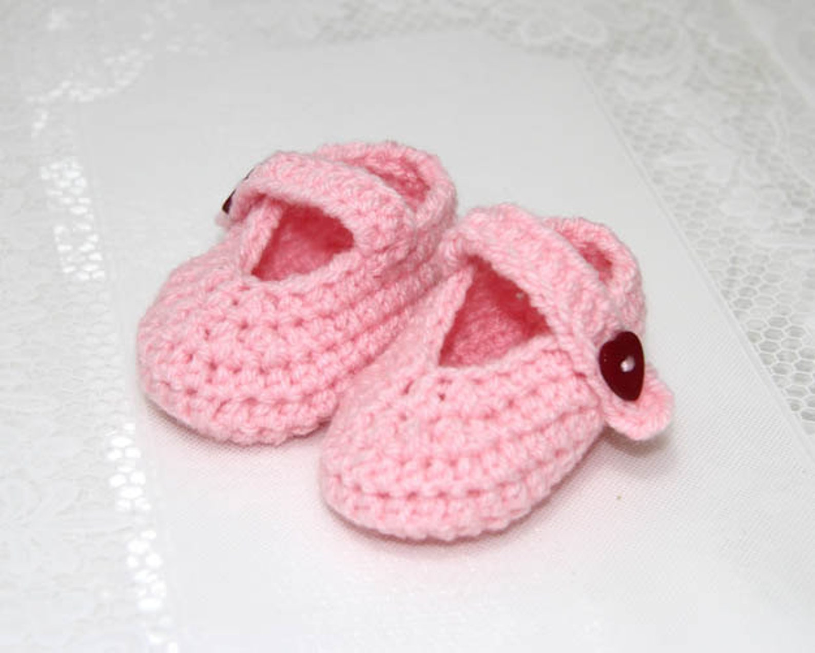 pink baby ballets shoes with heart shaped buttons