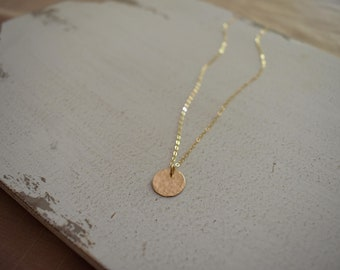 l u c y . Gold moon necklace. Textured 14k gold filled disc on dainty 14k gold filled chain. Minimalist, luxurious necklace.