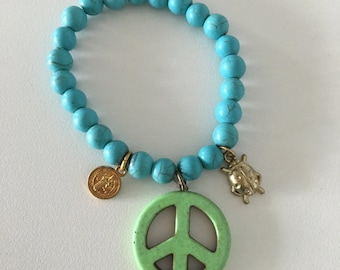 Green peace, coin, bug and turqoise stone bracelet.