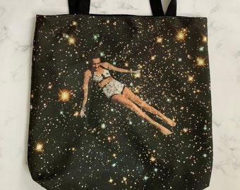 Swimmer in the universe tote bag